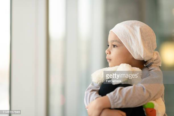 portrait of a young ethnic girl with cancer - paediatrician stock pictures, royalty-free photos & images