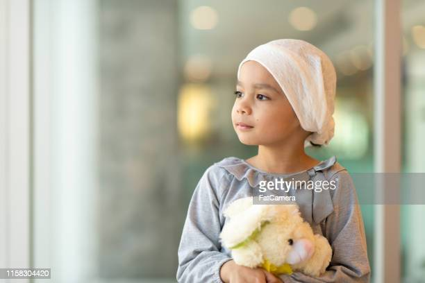 portrait of a young ethnic girl with cancer - cancer illness stock pictures, royalty-free photos & images