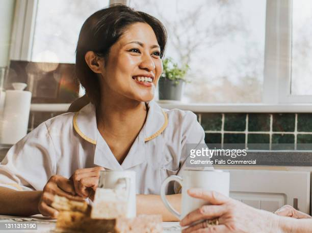 portrait of a young female carer - clap for carers stock pictures, royalty-free photos & images