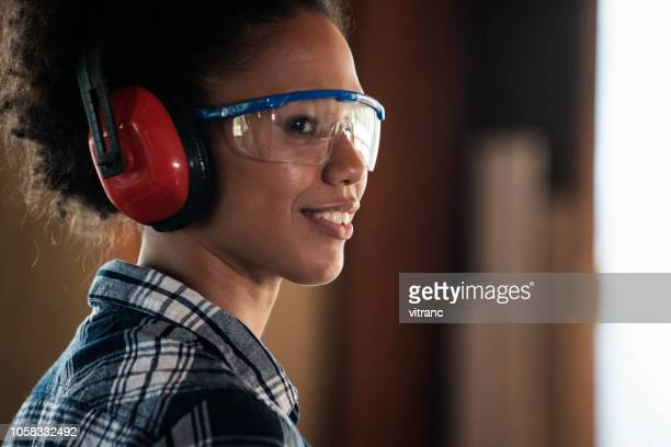 portrait of a young female carpenter - ear protection stock pictures, royalty-free photos & images