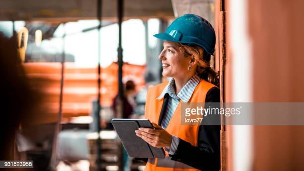 portrait of a young female supervisor - inspector stock pictures, royalty-free photos & images