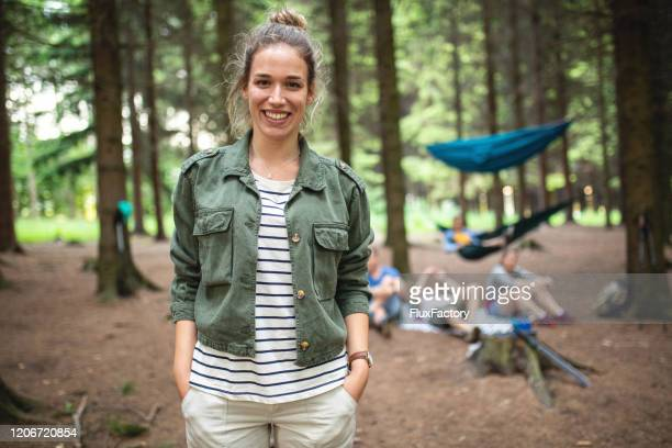 portrait of a young female survival expert - hands in pockets stock pictures, royalty-free photos & images