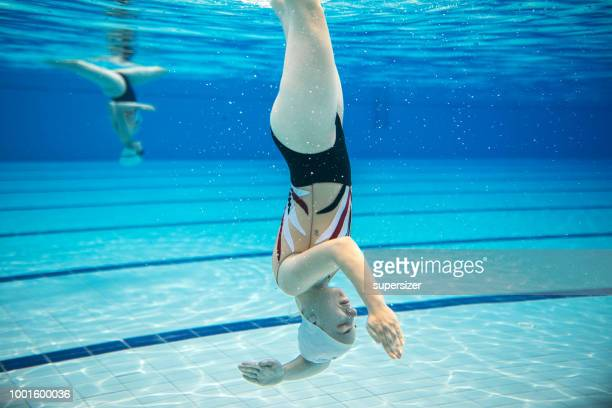 portrait of a young female swimmer - artistic swimming stock pictures, royalty-free photos & images
