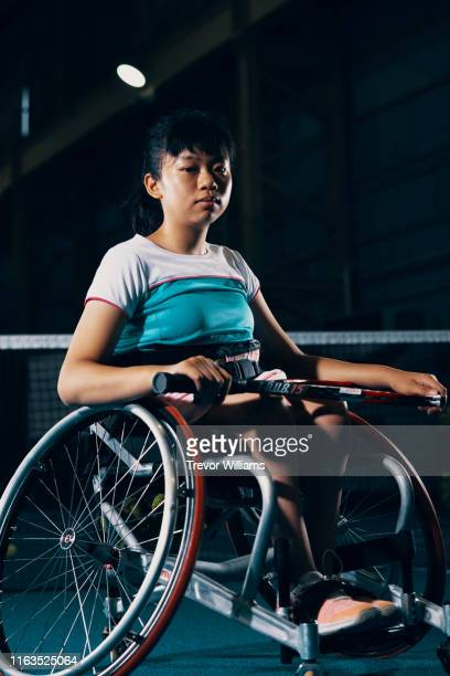 portrait of a young female wheelchair tennis player - 車いすテニス ストックフォトと画像