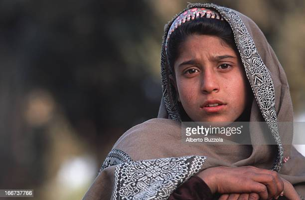 Portrait of a young girl Afghani girls over ten years of age are now free to walk in the streets without having to cover themselves with scarves as...