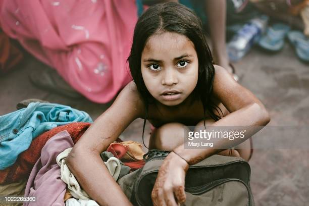 HARIDWAR UTTARAKHAND INDIA Portrait of a young girl after her bath in the Ganges river during the kumbh mela pilgrimage in Haridwar Uttarakhand India