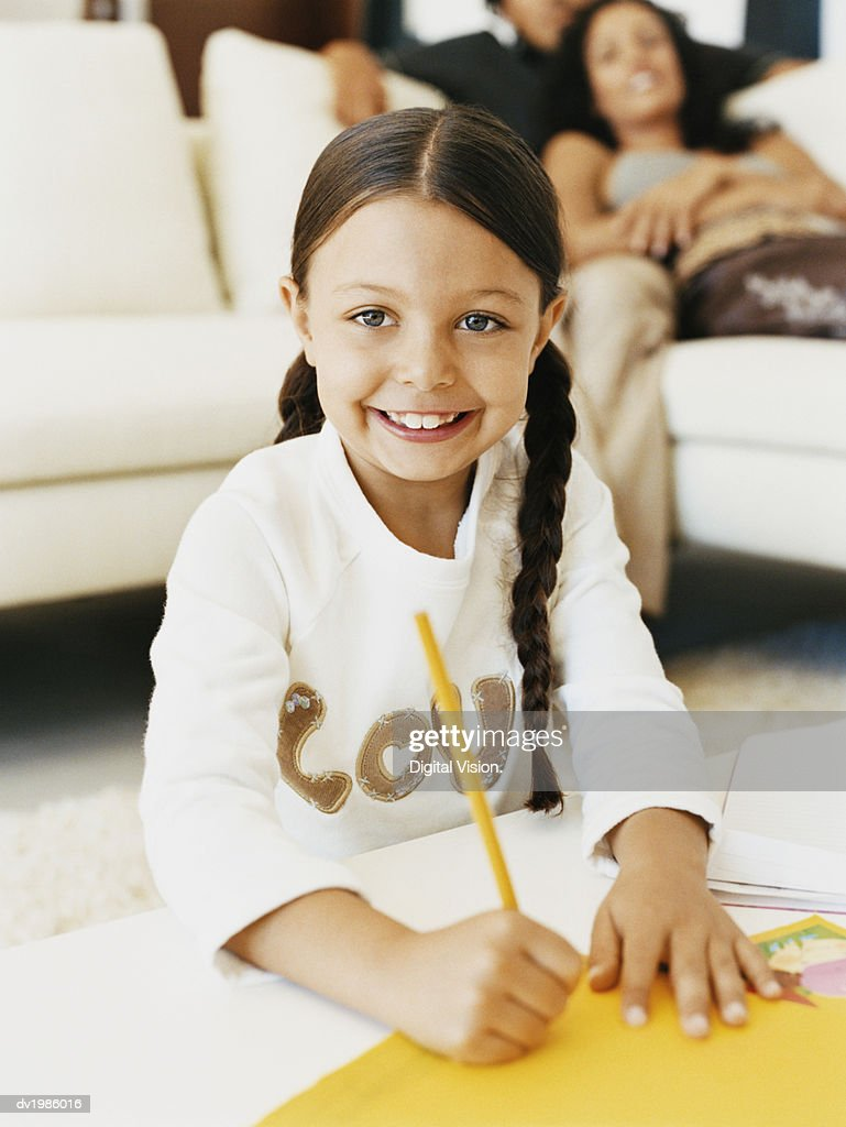 Portrait of a Young Girl Drawing : Stock Photo