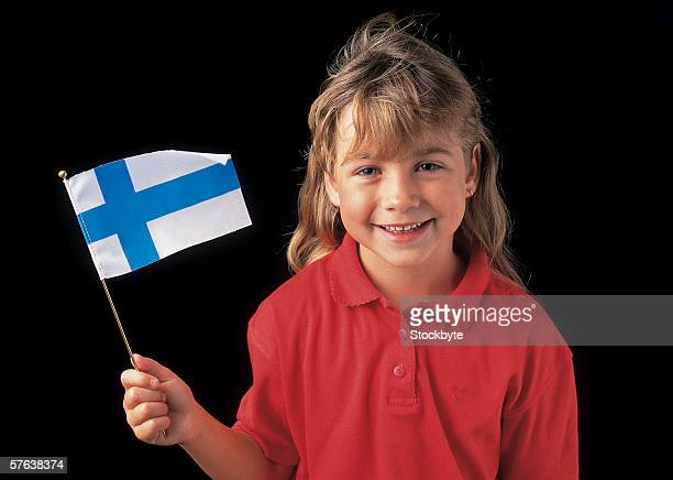 portrait of a young girl (4-6) holding the flag of finland - finsk flagga bildbanksfoton och bilder