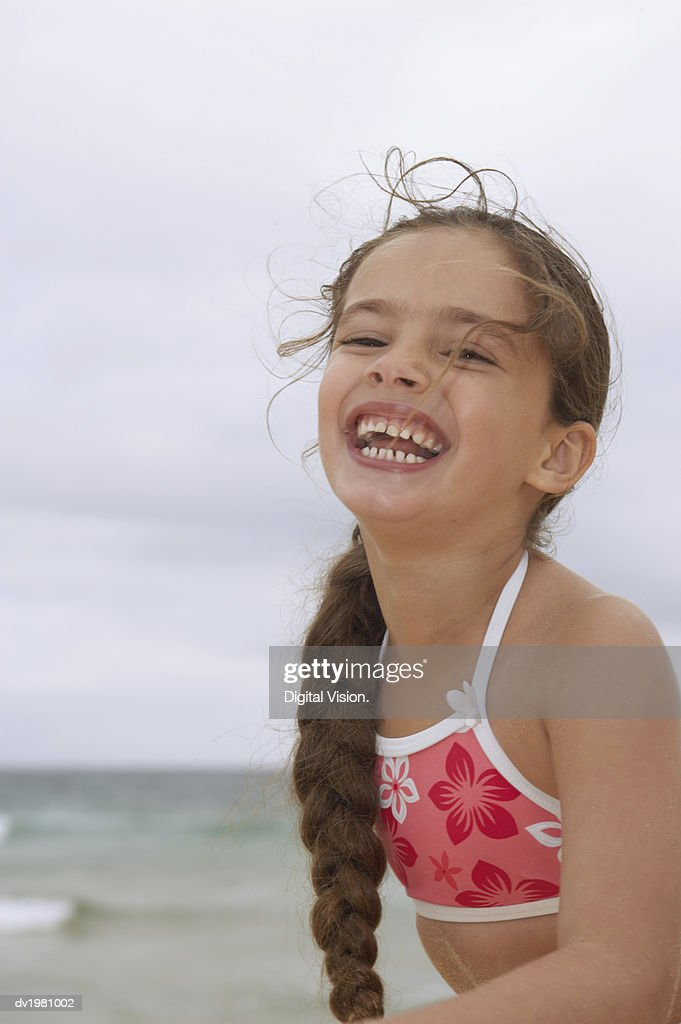 Portrait of a Young Girl in a Bikini Top, Laughing : Stock Photo