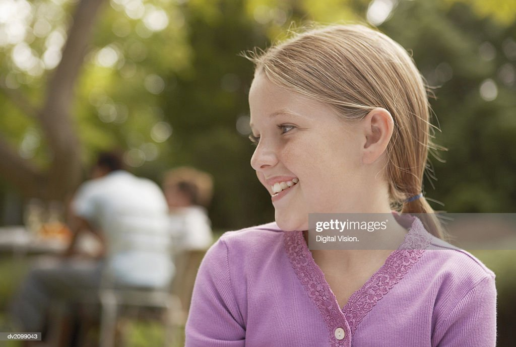 Portrait of a Young Girl in a Purple Cardigan : Stock Photo