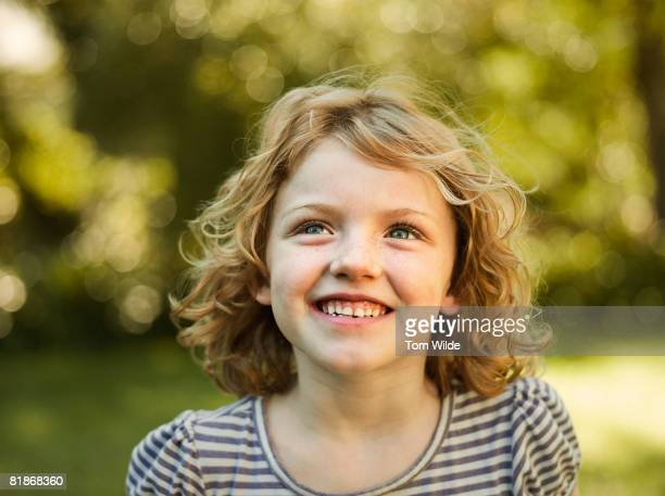 Portrait of a young girl in a stripy top