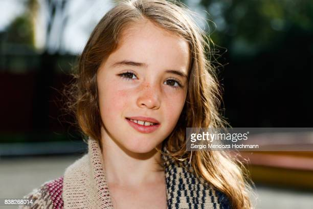 Portrait of a young girl looking at the camera and smiling