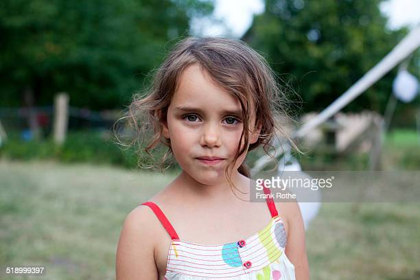 portrait of a young girl looking into a camera