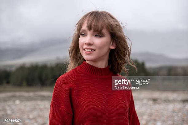 portrait of a young girl. mountain altai nature. tourist trip. beautiful girl in a red knitted sweater. - russia stock pictures, royalty-free photos & images