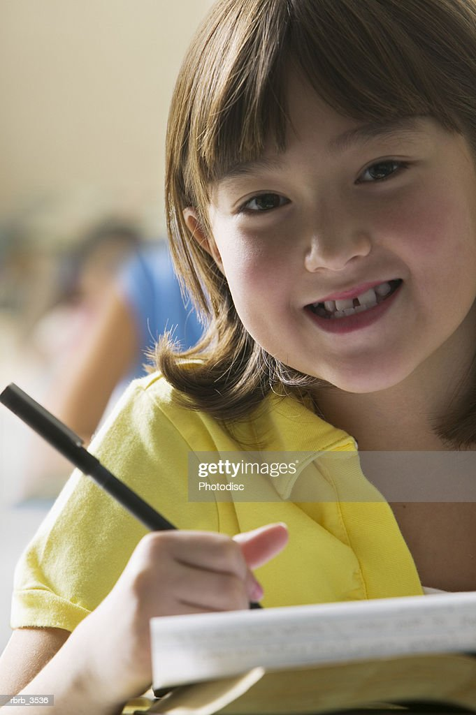 Portrait of a young girl (8-9) smiling : Foto de stock