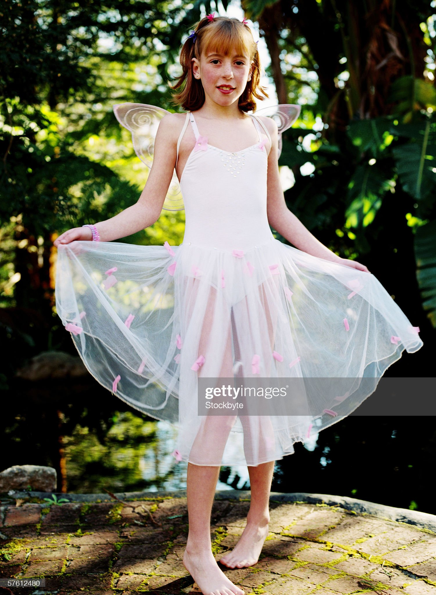 https://media.gettyimages.com/photos/portrait-of-a-young-girl-wearing-a-fairy-costume-picture-id57612480?s=2048x2048