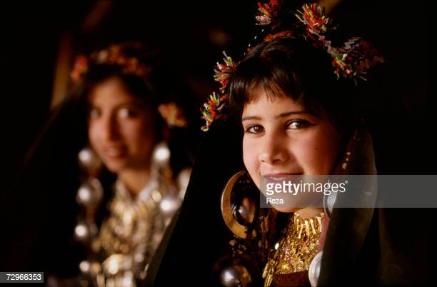 Portrait of a young girl wearing the traditional Berber clothing and jewelry during a folk festival on April 2000 in Kabaw Libya