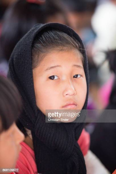 Portrait of a young girl with a sari while a ceremony inside a church in Kalimpong