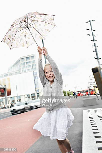 portrait of a young girl with an umbrella