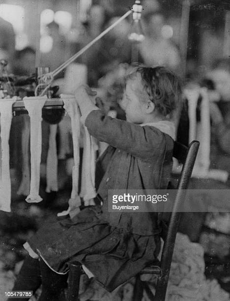 Portrait of a young girl working in the Cherokee Hosiery Mill, Rome, GA, 1913. The youngest work as turners and loopers.