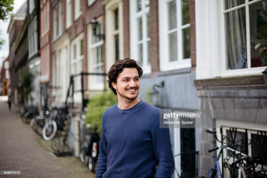 Portrait of a young handsome man on the streets of Amsterdam : Stock Photo