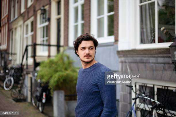 Portrait of a young handsome man on the streets of Amsterdam