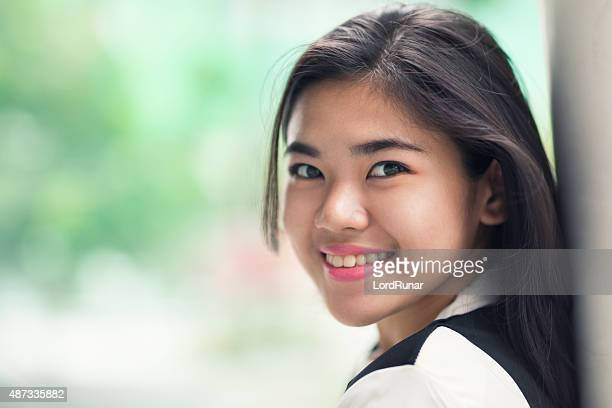 Portrait of a young happy female student