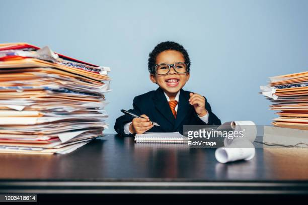 portrait of a young happy financial advisor - adult imitation stock pictures, royalty-free photos & images