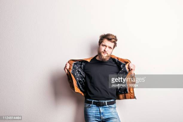 portrait of a young hipster man in a studio. copy space. - copy space - fotografias e filmes do acervo