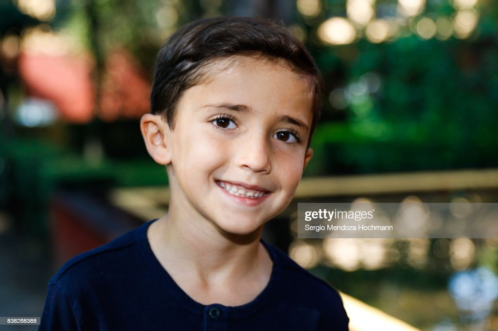Portrait of a young Hispanic boy looking at the camera and smiling : Foto de stock