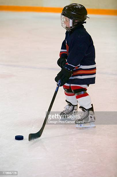 a portrait of a young hockey player - ice hockey rink stock pictures, royalty-free photos & images