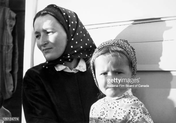 Portrait of a young Hutterite mother with her daughter Northeast Alberta Canada 1963 Photo taken during the National Film Board of Canada's...