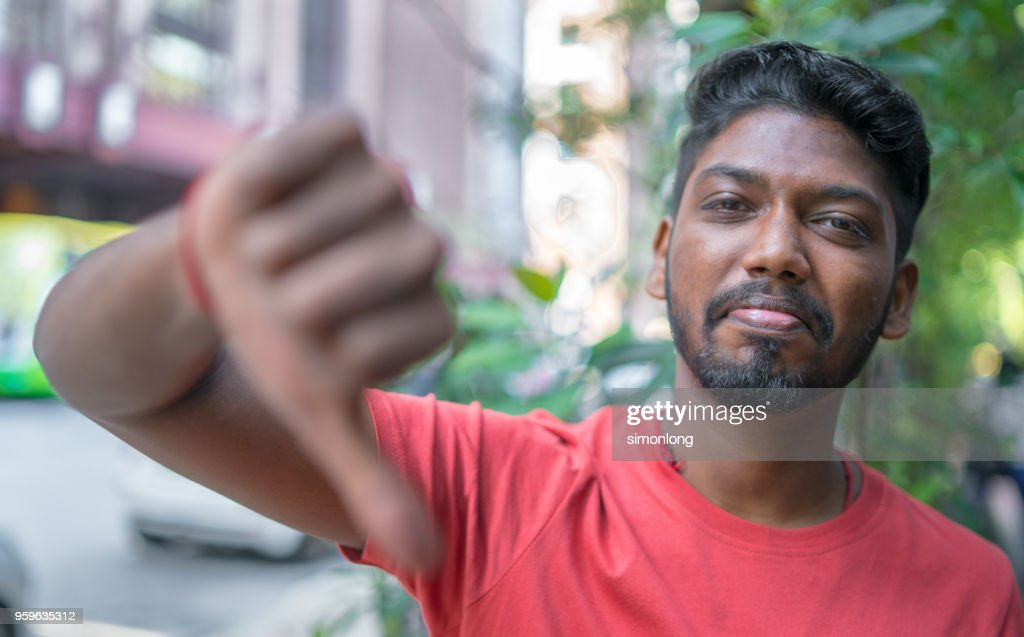 Portrait of a Young Indian Adult Man with Thumbs down Sign : Stock-Foto