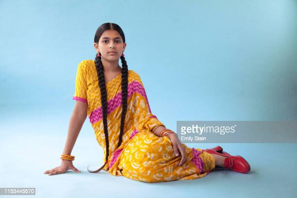 Portrait of a young Indian girl sitting