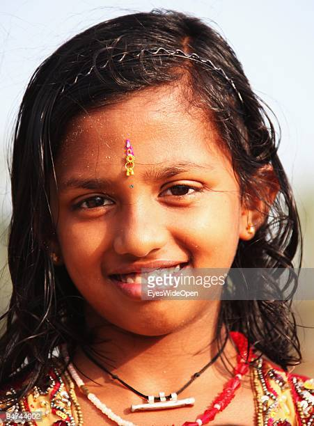 Portrait of a young indian girl with her bindi at the beach of Kovalam on December 13 2009 in Kovalam Beach near Trivandrum India