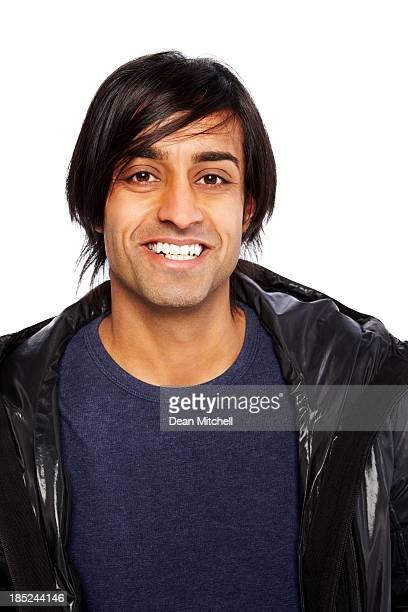Portrait of a young Indian guy against white background