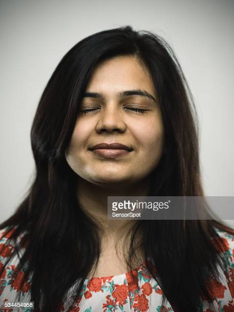 portrait of a young indian woman with relaxed expression - eyes closed stock pictures, royalty-free photos & images