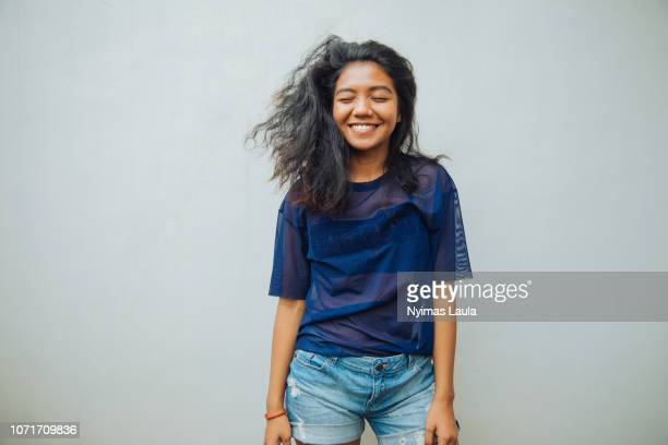 portrait of a young indonesian woman smiling. - south east asia stock pictures, royalty-free photos & images