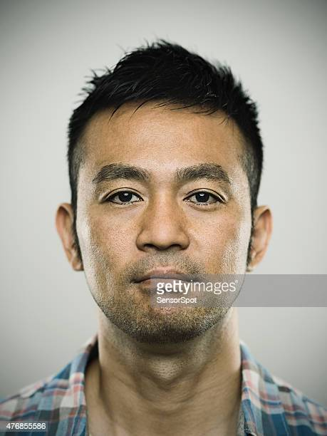portrait of a young japanese man looking at camera - east asia stock pictures, royalty-free photos & images