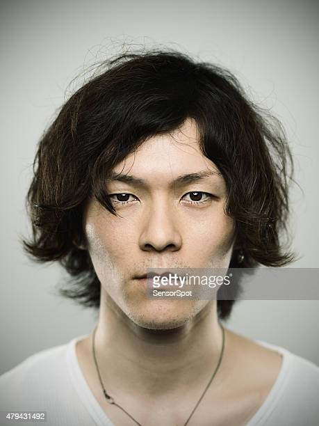 portrait of a young japanese man looking at camera - long hair stock pictures, royalty-free photos & images