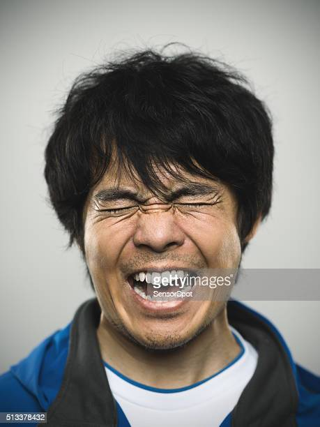 Portrait of a young japanese man under stress
