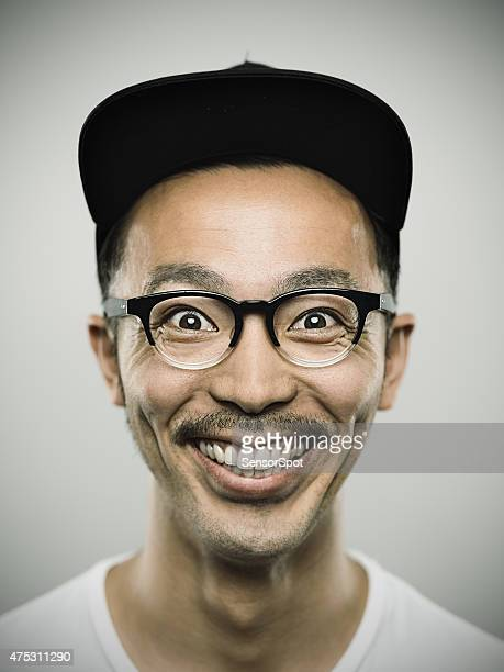 portrait of a young japanese man with big smile - stralende lach stockfoto's en -beelden