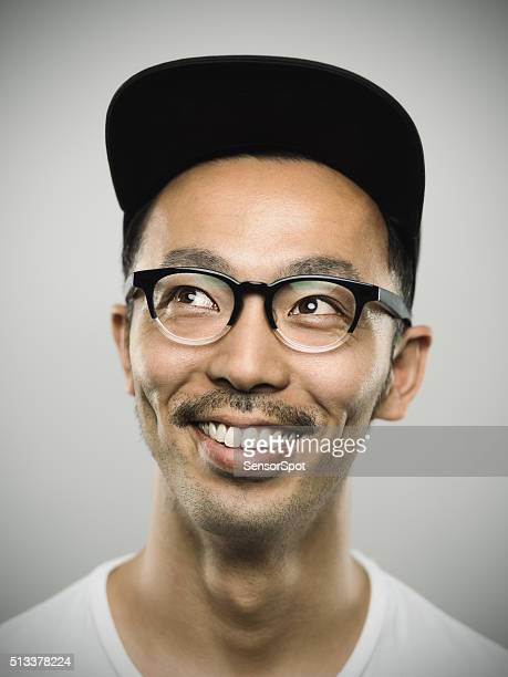 Portrait of a young japanese man with big smile