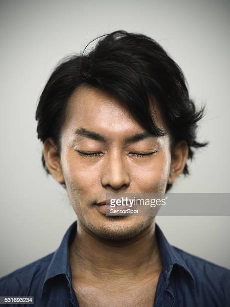 の肖像若い日本人男性の目に閉鎖いたします。