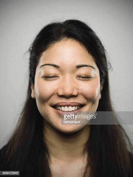 Portrait of a young japanese woman with closed eyes.