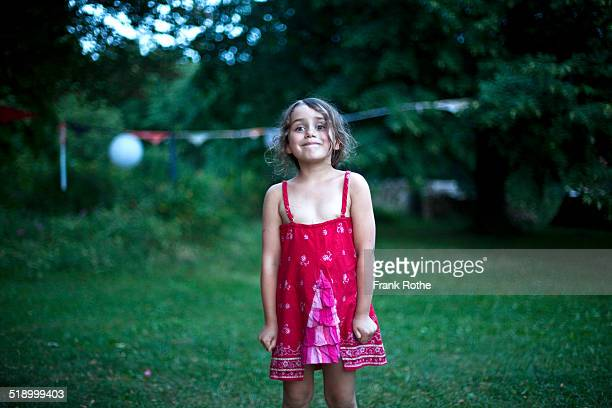portrait of a young kid with a nice red dress