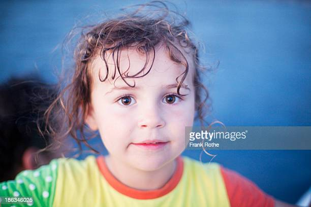 portrait of a young kid with big brown eyes