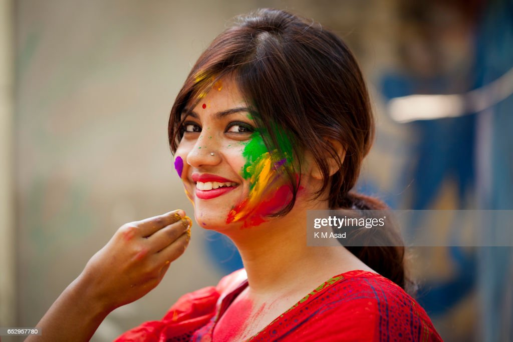 UNIVERCITY, DHAKA, BANGLADESH - : Portrait of a young lady celebrate the Holi Festival or Festival of Colors after smearing each other with colored powder in Dhaka, Bangladesh. Holi festival is celebrated on the full moon day in the month of Phalguna and marks the start of the spring season.