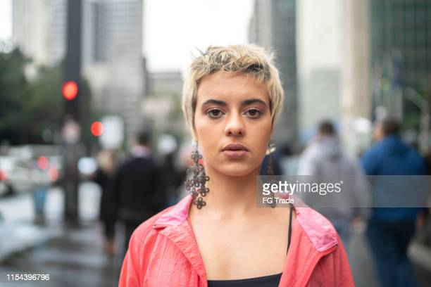portrait of a young latin woman in the city - short hair stock pictures, royalty-free photos & images