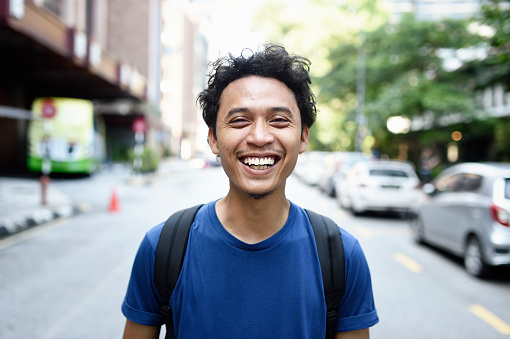 Portrait of a young Malay man on the street - gettyimageskorea